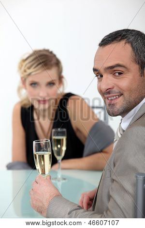 Successful couple toasting with champagne