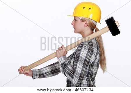 Woman using sledge-hammer