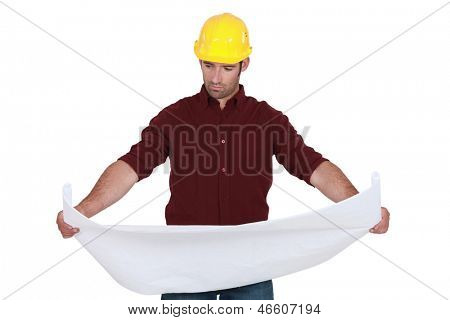 Tradesman examining a technical drawing