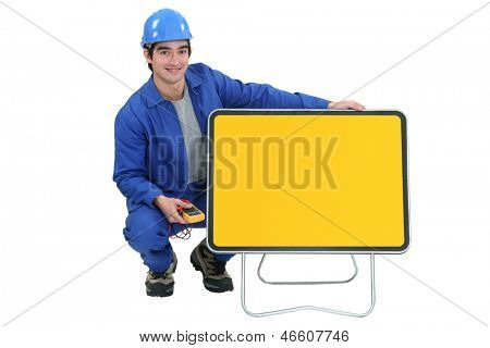 young electrician posing