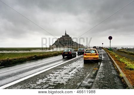 Cars On Wet Road And Mont Saint-michel, France