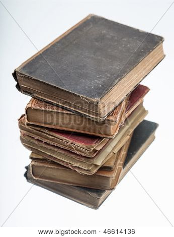 Stack of old book with reflection