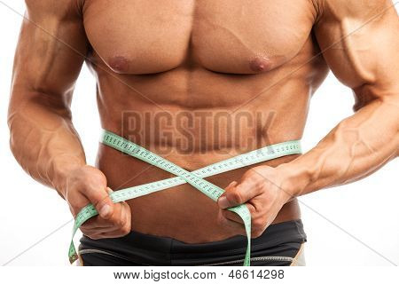 Closeup of muscular man with measuring tape