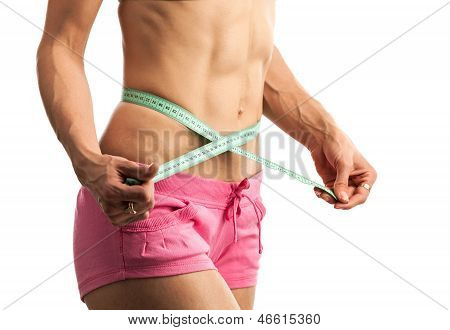 Cropped view of woman with measuring tape