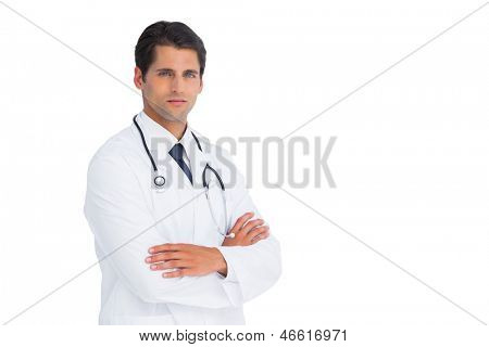Handsome doctor with arms crossed on white background