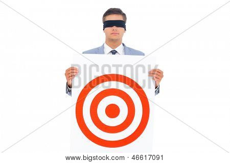 Man with blindfolded holding a target
