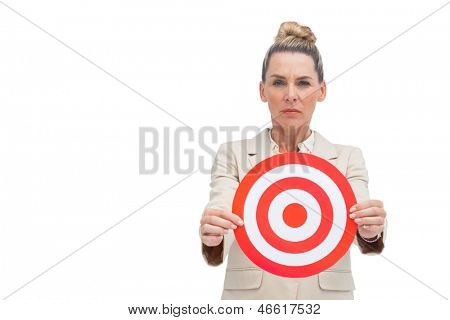 Frowning businesswoman holding target in front of the camera