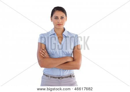 Young businesswoman standing alone with her arms crossed on white background