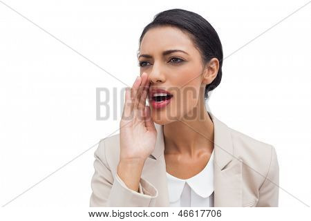 Businesswoman calling for someone on white background