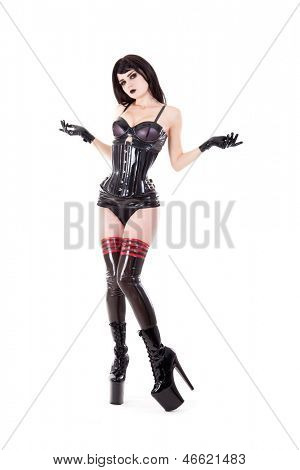 Fetish woman in latex outfit and high heels, isolated on white background