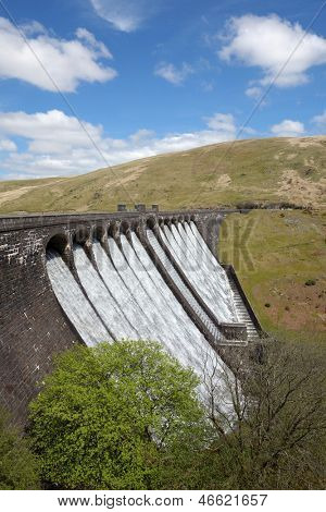 The Claerwen reservoir dam overflowing, Elan Valley Wales UK.