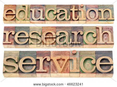 education, research and service words - possible university or college tagline or statement - isolated text in letterpress wood type