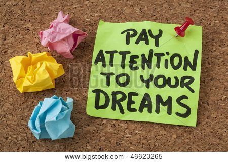 pay attention to your dreams - motivation or self improvement concept - handwriting on colorful sticky notes