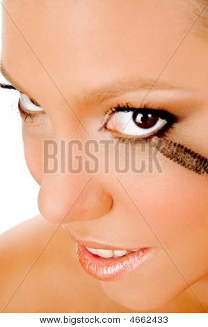 Close Up Of Young Woman Getting Makeup
