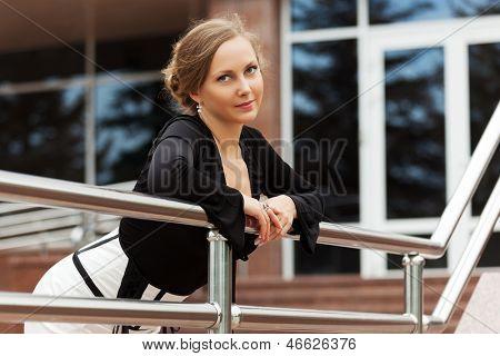 Beautiful woman against office windows
