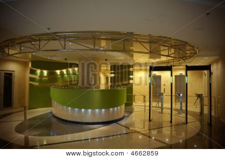 Modern Building Entrance With Security Check Point In Front