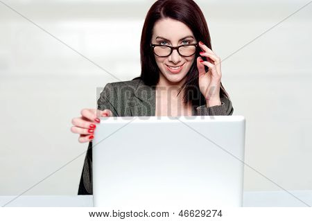 Lets Call It A Day. Woman Shutting Down Laptop