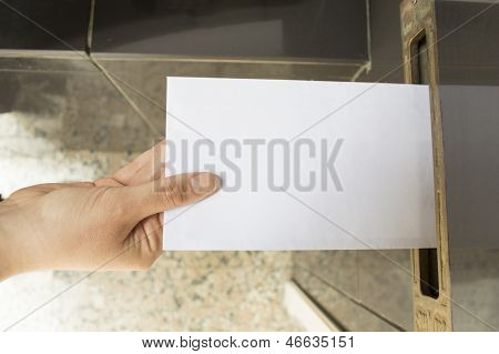 delivering a letter into a mailbox white
