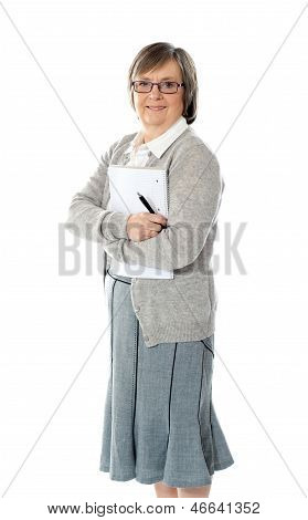 Senior Woman Holding Spiral Notepad And Pen