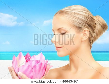 bright picture of lovely woman with lotos flower