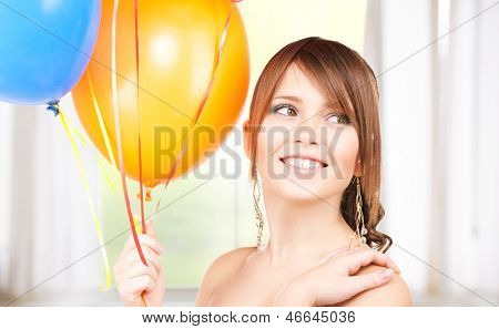happy teenage girl with balloons at home