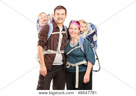 Happy family with hiking backpacks posing isolated on white background