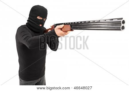 A man with robbery mask attacking someone with shotgun isolated on white background