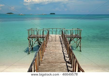 Pier on a tropical paradise beach
