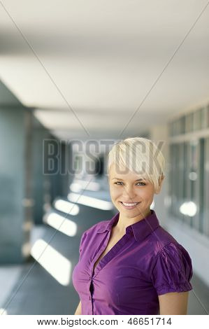 Happy Businesswoman Looking And Smiling At Camera