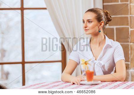 Pretty woman in cafe