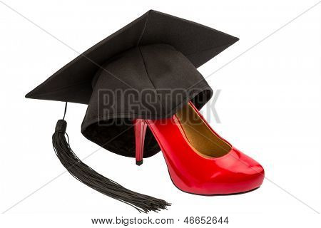 a red ladies shoes on a mortarboard symbol photo for gender equality and women power