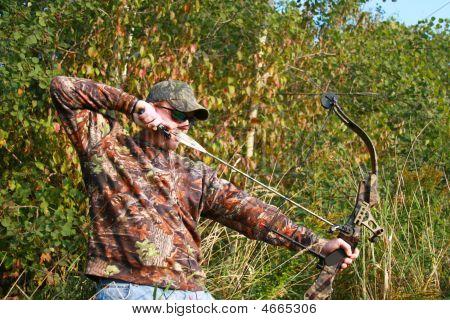 Bow Hunter Shooting