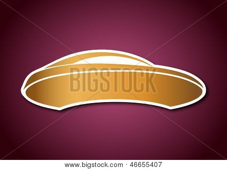 Golden auto logo over pink board