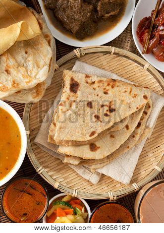 Indian bread, Chapati flatbread, roti canai, dal, curry, teh tarik or pulled tea, acar. Famous indian food.