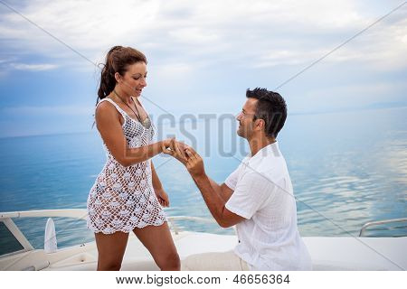 Young couple on their yacht at sea