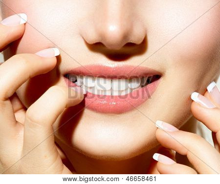 Healthy Skin, Manicured Nails and White Teeth closeup. Beauty Girl, Healthy Young Woman close-up. Teeth Whitening Concept