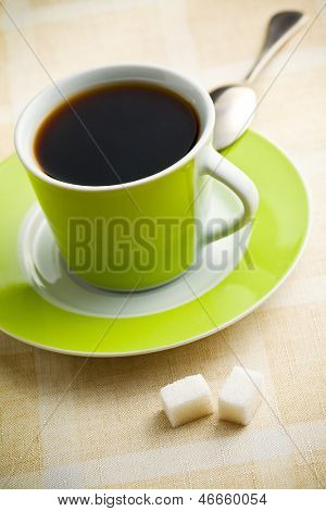 the black coffee in green cup