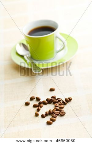 the coffee beans on retro tabelcloth