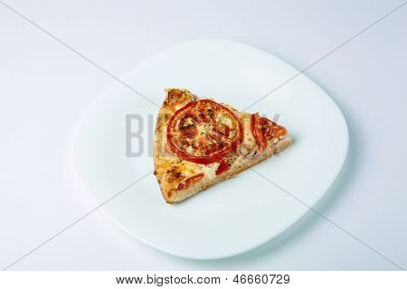 A Slice Of Pizza On A White Plate