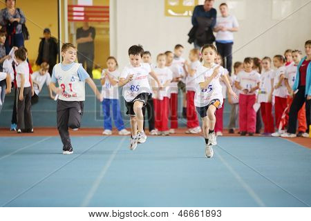 MOSCOW - DEC 1: Little boys run in stadium at children competition under auspices of MOSCOMSPORT in Physical Culture Institute, on Dec 1, 2012 in Moscow, Russia.