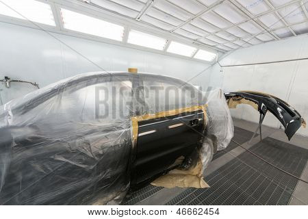 MOSCOW - SEP 21: Car door and bumper after painting on body shop Avtostandart on September 21, 2012 in Moscow, Russia.