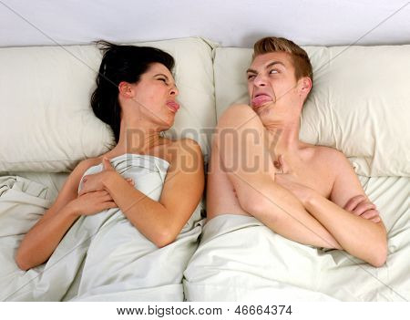 Anger couple fighting and discussing on bed.disagree couple on bed.
