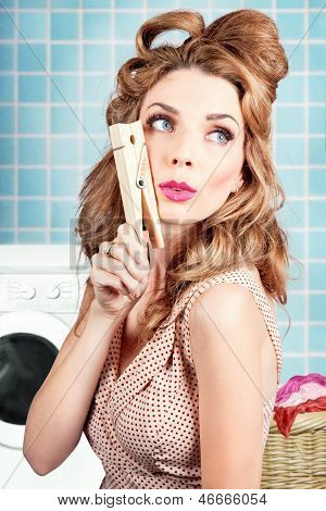 Gorgeous Pin-up Woman Holding Large Cleaning Peg