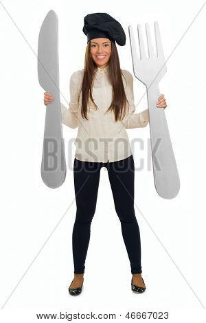 Female Chef Holding Butterknife And Fork Over White Background