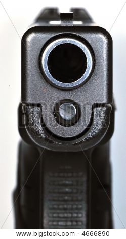 Looking Down Barrel Of Semi-automatic Handgun