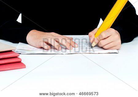 Closeup Shot Of School Boy Doing Homework