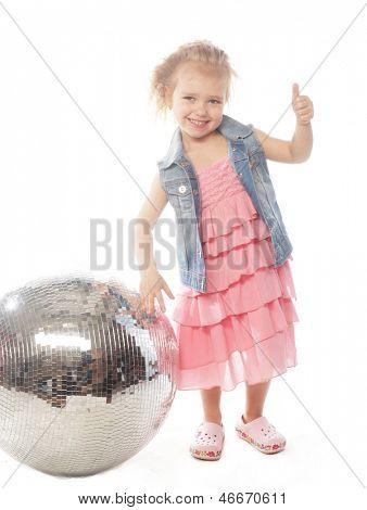 little girl in pink dress with disco ball