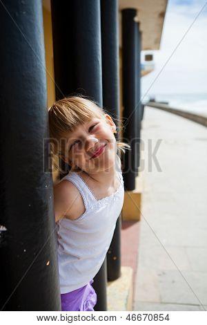 Young Girl On Beachside Walkway