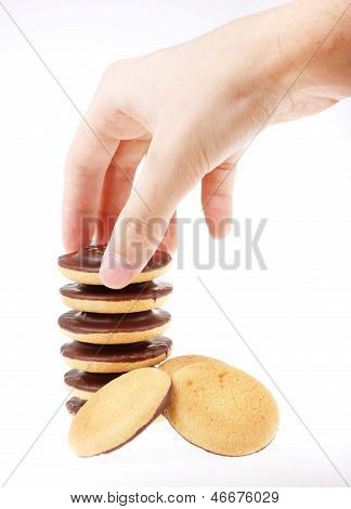 Chocolate Cookies And Hand Isolated On A White Background.