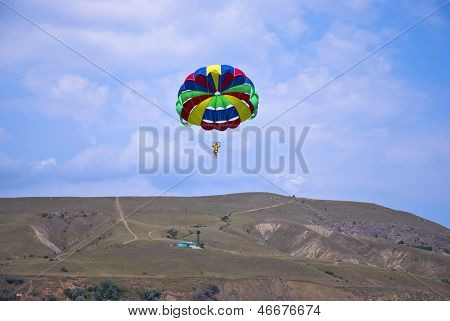 Flying Paraglider In The Mountain